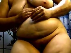 Fat granny masturbates in the shower
