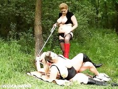 Bbw dommes play with their slave in the woods