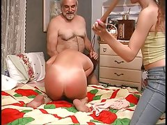Slut gets down on the bed and guy spanks her..