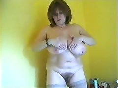 Mature shows off huge titties and more