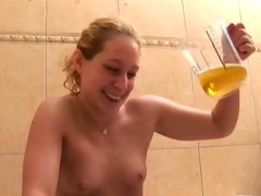 Blonde pours herself with glass of piss