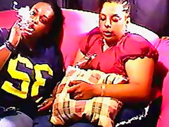 Chubby black chicks smoke on the couch
