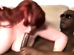 Big beautiful redhead gets a big black cock