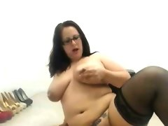 Bbw in glasses riding a toy in front of her web..