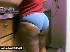 Large ebony girl in the kitchen